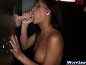 Gloryhole enjoying tanned sexually excited lassie facialized