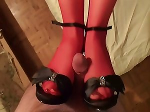 Cumming on her red nylons