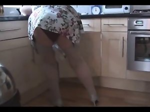 Unshaved granny in nylons undresses and widens