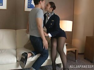 Sexy stewardess is an Oriental doll in lofty heelpieces