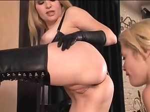 Naughty dominas torment their feminine slaves