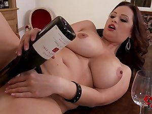 Weighty chested Sirale masturbates with grape flacon