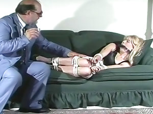 Tied and gagged golden-haired lassie
