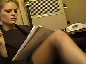 Office playgirl in nylons and suit