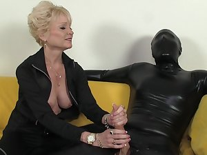 Aged goddess and her serf in latex