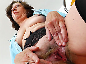Former tend bangs her curly vagina on the stretcher