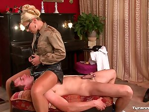 Lady in leather petticoat abuses him