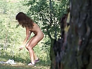 Undressed lass with sexy milk sacks pees outdoors
