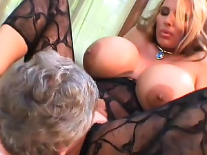 Breasty blond gives a hawt titjob on the web camera