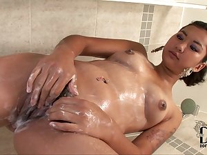 Carnal Oriental honey Sofie is pissing in the pool