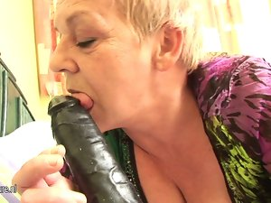 Messy European granny game with her toy