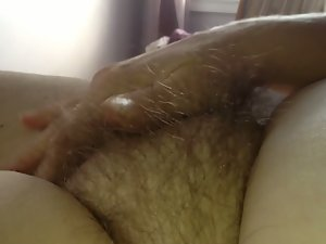 watch whence my immodest wife detect pleasure in caressing her be in curly pussy