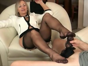 Experienced with dark hose footjob