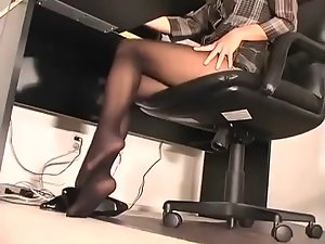 Beauteous petite secretary operating in ebon hose