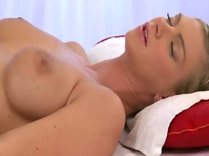 Lesbian masseuse rubs clients racy pussy with her fingers